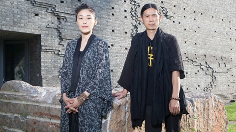 RongRong and Inri in the courtyard of their Three Shadows gallery in Caochangdi