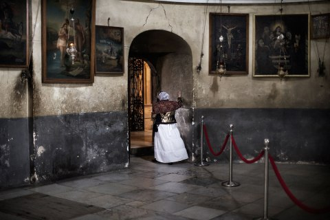 Image: An eastern European pilgrim walks away from the Armenian section of the Church of the Nativity in the West Bank city of Bethlehem, Dec. 24, 2011.