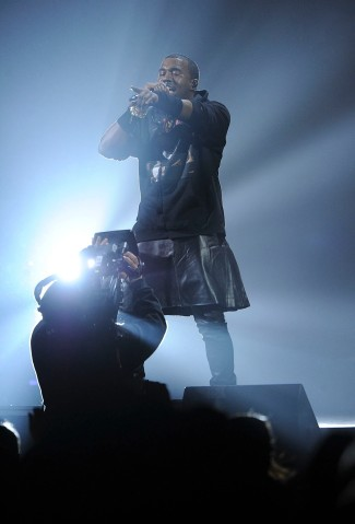 """Rapper Kanye West performs at """"12-12-12"""" a concert benefiting The Robin Hood Relief Fund to aid the victims of Hurricane Sandy at Madison Square Garden on Dec. 12, 2012 in New York City."""