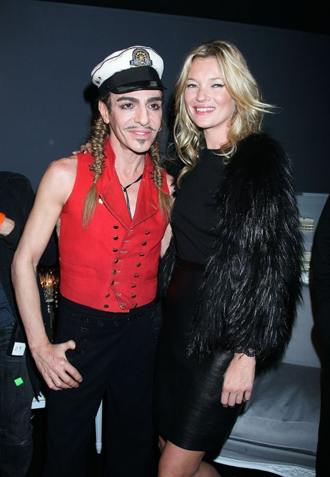 John Galliano and Kate Moss pose for a photo at Dior Ready to Wear Spring-Summer 2010 Fashion Show in Paris, Oct. 01, 2010.