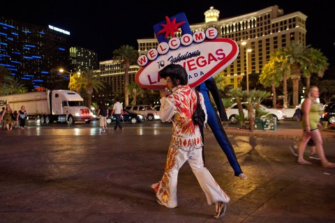Image: One of Vegas' many Elvis impersonators works the Strip