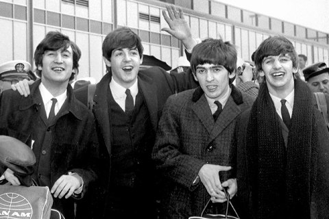 Throng is on hand to greet the Beatles as they stepped trium