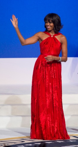 Michelle Obama wears a red, velvet and chiffon gown designed by Jason Wu