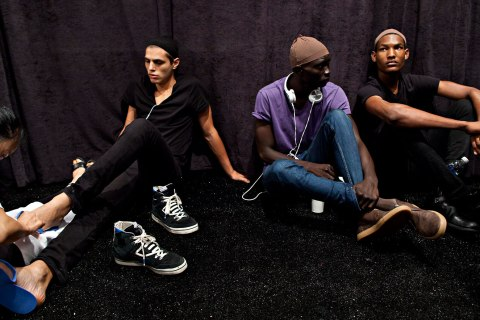 Models wait during the Nicholas K Spring/Summer 2013 collection during New York Fashion Week, Sept. 6, 2012.