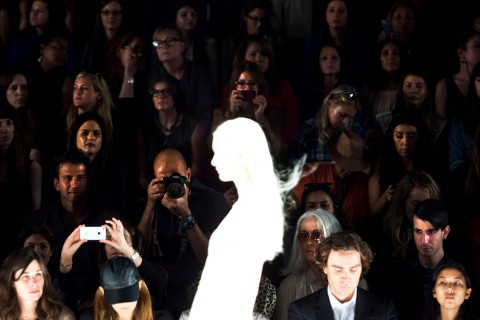Audience members watch a model during the J. Mendel Spring/Summer 2013 show at New York Fashion Week, Sept. 12, 2012.