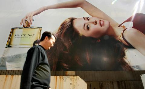 A man walks past a billboard advertising